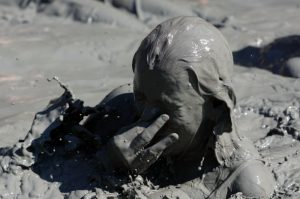 A woman bathes in mud in the western Turkish resort town of Dalyan